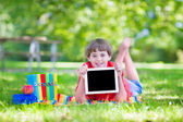 Happy school boy with a tablet pc — Stock Photo