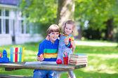 Two kids in a school yard — Stock Photo