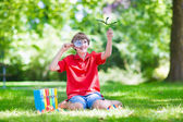 Happy child with magnifying glass — Stock Photo