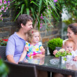 Family eating lunch in outdoor cafe — Stock Photo #51614807