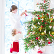 Kids decorating Christmas tree — Stock Photo #51615123
