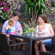 Family eating lunch in outdoor cafe — Stock Photo #51615255