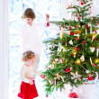 Children decorating Christmas tree — Stock Photo #51615275
