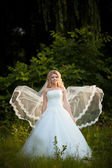 Beautiful bride cute seen played her dress — Stock Photo