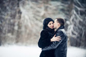 Couple in love kissing in the winter forest — Stock Photo