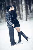 Couple in love kissing in the winter forest — Стоковое фото
