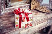 Retro gift on vintage wooden table — Stock Photo