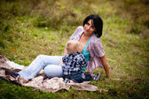 Mother breast feeding her son — Stock Photo