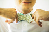 Photo of a man correcting his bowtie — Stockfoto