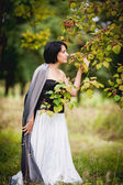 Portrait of woman in nature — Stock Photo