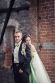Wedding. bride and groom embracing against the backdrop of an old building — Stok fotoğraf