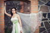 Wedding. bride embracing against the backdrop of an old building — Stok fotoğraf