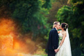 Wedding. married couple in forest embracing, young groom and bride — Stock Photo