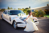 Happy bride near retro car — Stok fotoğraf