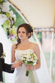 Bouquet in the hands of the bride — Stock Photo