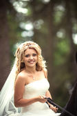 Wedding. Portrait of beautiful bride on a the horse — Stock Photo