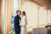 Wedding. newlyweds sitting in a cozy cafe in beige scenery — Stock Photo