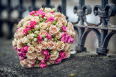 Wedding bouquet of roses lying on the street — Stock Photo