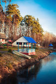 A gazebo located on the shore of a small lake — Stock Photo