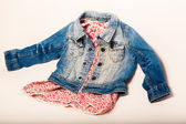 Denim jacket combined with a beautiful red dress — ストック写真