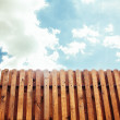 Old wooden fence with gate on sky background - rendering — Stock Photo
