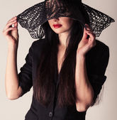 Fashionable portrait of a beautiful woman in a hat. stylish model — Stock Photo