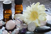 Gemstones with essential oils — Stock Photo