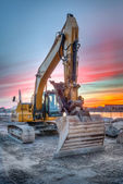 Excavator on sunset landscape — Stock Photo