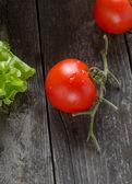 Tomato on old grey wood — Stock Photo