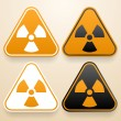 Set of triangular signs of danger of white, black and orange color. Radiation warning sign — Stock Vector #48069681