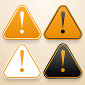 Set of triangular signs of danger of white, black and orange color. Warning sign — Stockvector