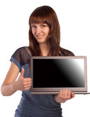 Happy young woman showing laptop screen — Stock Photo