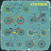 Vintage retro bicycles doodle set print on old carton card — Stock Vector