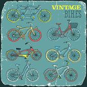 Vintage retro bicycles doodle set print on old carton card — Vector de stock