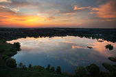 Lake at the sunset from a height — Foto Stock