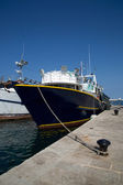 Fishing boat in the port — Stock Photo