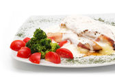 Chicken with gorgonzola, vegetables and bread on the plate — Stock Photo