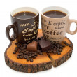 Two cups of coffee, chocolate hearts and coffee beans on the stump isolated — Stock Photo #45178573