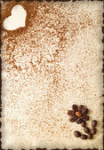 Heart made of ground coffee and flower made of coffee beans on a vintage  paper — Stock fotografie