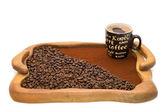 Cup of coffee, ground coffee and coffee beans on a wooden tray — Stock Photo
