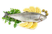 Fresh trout with parsley, lemon and olives isolated on white — Stock Photo