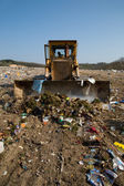 The old bulldozer moving garbage — Stock Photo