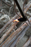 Cutting of steel pipes with acetylene torch — Stock Photo