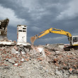 Bulldozer removes the debris from demolition of old derelict buildings — Stock Photo #48875753