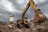 Bulldozer removes the debris from demolition of old derelict buildings — Stockfoto
