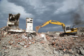 Bulldozer removes the debris from demolition of old derelict buildings — Stock Photo