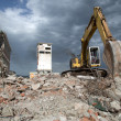 Bulldozer removes the debris from demolition of old derelict buildings — Stock Photo #48989363