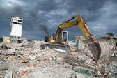 Bulldozer removes the debris from demolition of old derelict buildings — 图库照片