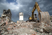 Bulldozer removes the debris from demolition of old derelict buildings — Photo