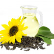 Sunflower and Seeds with Green Leaves and Sunflower Oil in Glass Pitcher Isolated on White — Stock Photo #50465029
